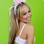 Celeste4. Graceful blonde bunny girl Celeste just loves flashing her little white tail!